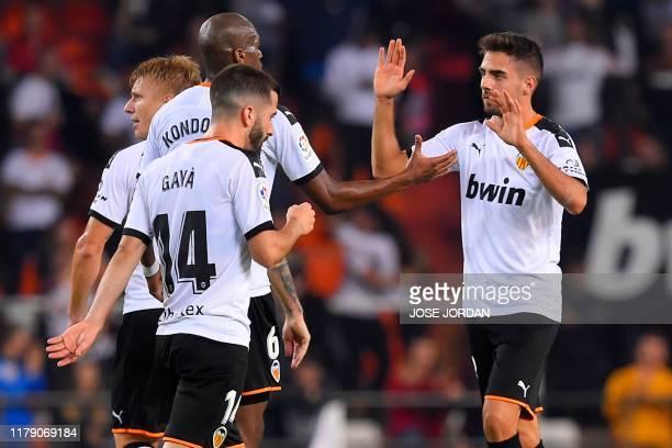 Valencia's Spanish forward Ruben Sobrino celebrates with teammates after scoring a goal during the Spanish league football match between Valencia CF...