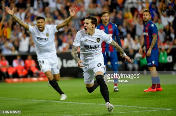 Valencia's Spanish forward Santi Mina celebrate after scoring during the Spanish league football match between Valencia CF and Levante UD at the...