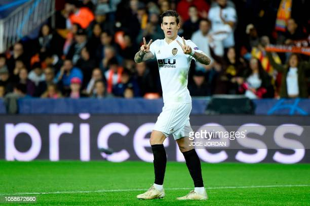 Valencia's Spanish forward Santi Mina celebrates after scoring a goal during the UEFA Champions League group H football match between Valencia and...