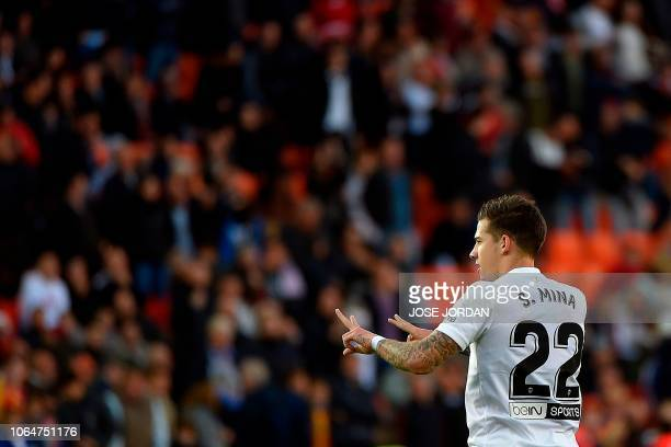 Valencia's Spanish forward Santi Mina celebrates after scoring a goal during the Spanish league football match between Valencia and Rayo Vallecano at...