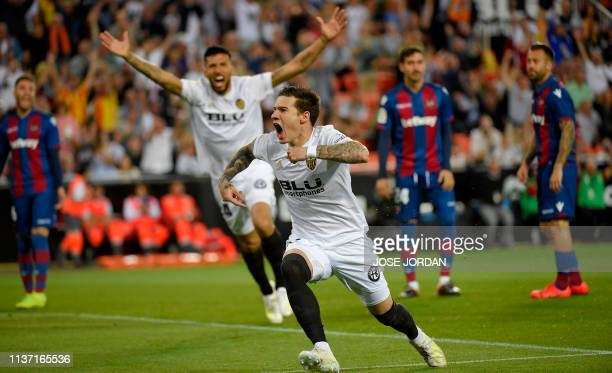 Valencia's Spanish forward Santi Mina celebrates after scoring during the Spanish league football match between Valencia CF and Levante UD at the...