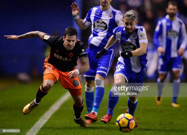 Valencia's Spanish forward Santi Mina vies with Deportivo La Coruna's Portuguese defender Luisinho during the Spanish league football match between...
