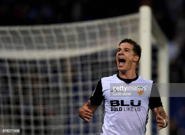 Valencia's Spanish forward Santiago Mina Lorenzo celebrates a goal during the Spanish league football match RCD Espanyol vs Valencia CF atthe RCDE...