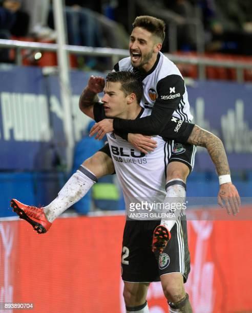 Valencia's Spanish forward Santiago Mina Lorenzo celebrates a goal with Spanish midfielder Nacho Gil during the Spanish league football SD Eibar...