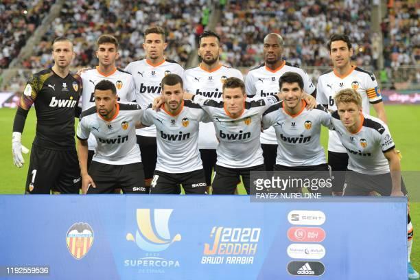 Valencia's Spanish goalkeeper Jaume Domenech, Valencia's Spanish midfielder Ferran Torres, Valencia's Brazilian defender Gabriel Paulista, Valencia's...