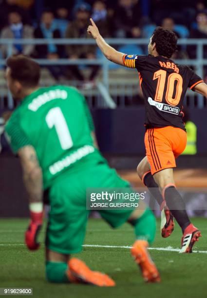 Valencia's Spanish midfielder Dani Parejo celebrates scoring a goal during the Spanish league football match between Malaga CF and Valencia CF at La...
