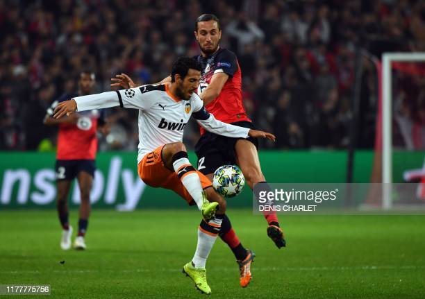 Valencia's Spanish midfielder Daniel Parejo and Lille's Turkish midfielder Yusuf Yazici vie for the ball during the UEFA Champions League Group H...