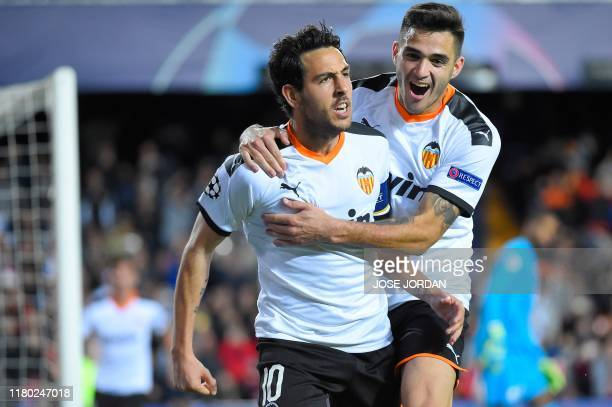 Valencia's Spanish midfielder Daniel Parejo celebrates with teammate after scoring a goal during the UEFA Champions League group H football match...
