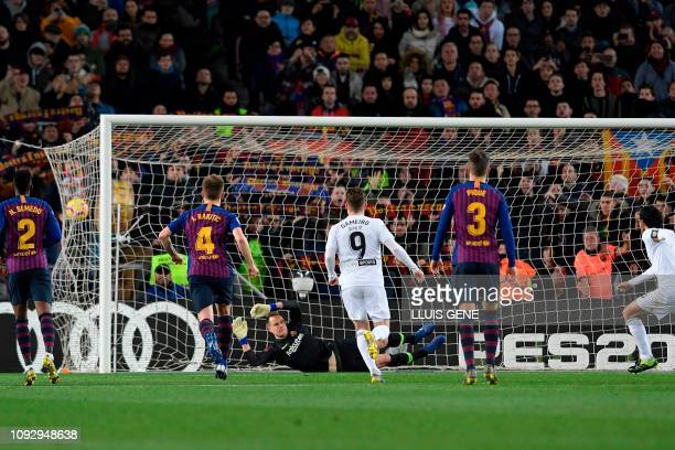 Valencia's Spanish midfielder Daniel Parejo scores a penalty kick against Barcelona's German goalkeeper Marc-Andre Ter Stegen during the Spanish...
