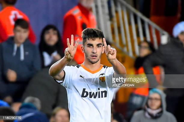 Valencia's Spanish midfielder Ferran Torres celebrates after scoring the fourthand last goal during the UEFA Champions League group H football match...