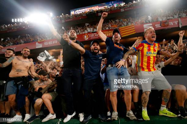 Valencia's supporters celebrate after their team won the 2019 Spanish Copa del Rey final football match against Barcelona at the Benito Villamarin...