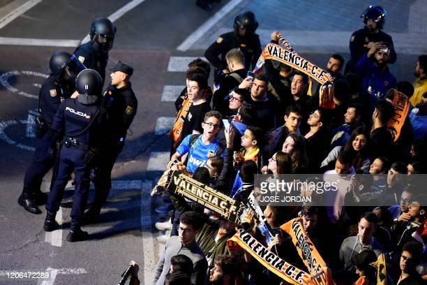 Valencia´s supporters gather outside the Mestalla stadium in Valencia on March 10, 2020 before the UEFA Champions League round of 16 second leg...