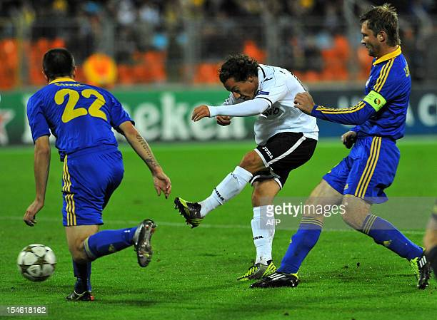 Valencia's Tino Costa vies with BATE Borisov's Marko Simic and Aleksandr Pavlov during their Champions League Group F football match in Minsk on...