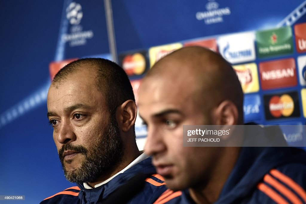 Valencia's Tunisian defender Aymen Abdennour (R) and Valencia's Portuguese coach Nuno Espirito Santo (L) take part in a press conference on the eve of the Champions League football match Olympique Lyonnais (OL) vs Valencia CF on September 28, 2015 at the Gerland Stadium in Lyon, central-eastern France.