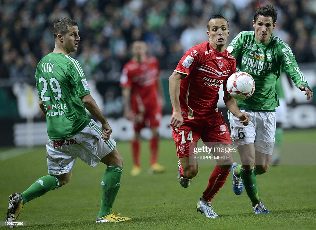Valenciennes' Algerian midfielder Foued Kadir (C) fights for the ball with Saint-Etienne's French midfielder Jeremy Clement (R) and Saint-Etienne's French defender Francois Clerc during the French L1 football match Saint-Etienne vs Valenciennes, on November 23, 2012 at the Geoffroy-Guichard stadium in Saint-Etienne.