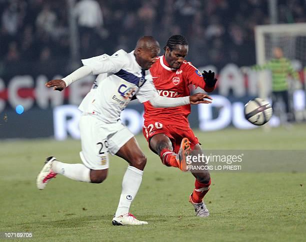 Valenciennes' Benjamin Angoua vies with ArlesAvignon's Franck Dja Djedje during the French football L1 match Valenciennes vs Arles Avignon on...