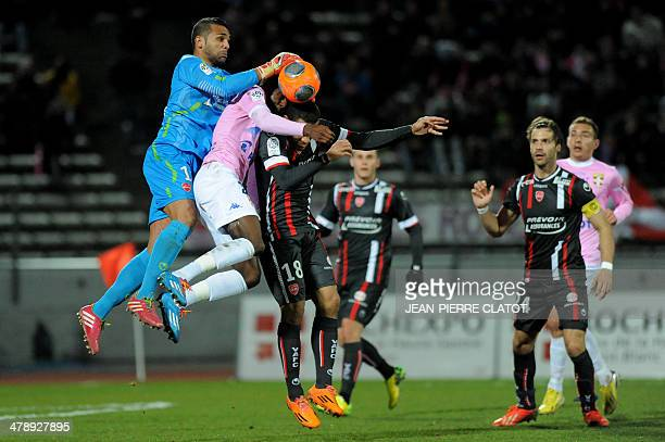 Valenciennes' Brazilian goalkeeper Novaes Magno grabs the ball during the French L1 football match EvianThonon vs Valenciennes at the Parc des Sports...