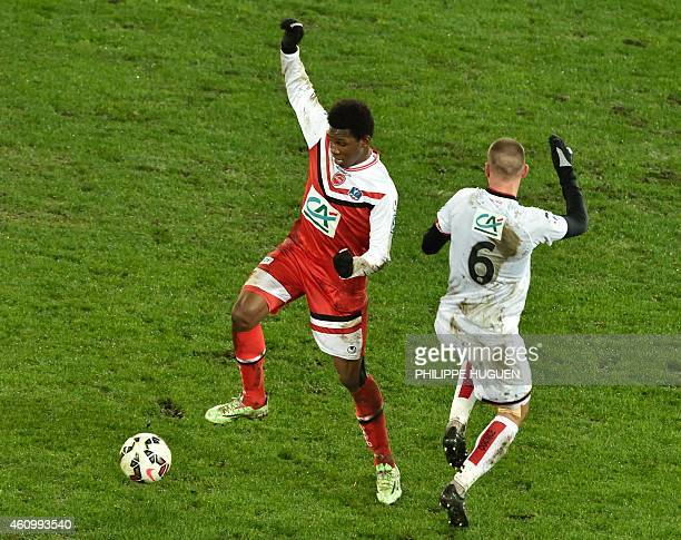 Valencienne's forward Abdoul Kabore vies with Nice's midefielder Didier Digard during the French Cup football match Valenciennes vs Nice on January 3...
