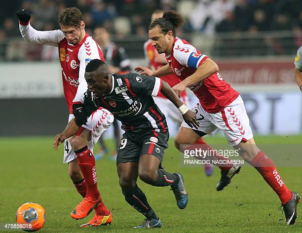 Valenciennes' forward Abdul Majeed Waris vies with Reims' midfielder Grzegorz Krychowiak and Reims' defender Mickael Tacalfred during the French...