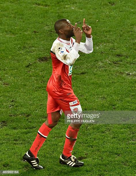 Valencienne's Forward Adama Coulibaly celebrates after scoring a goal during the French Cup football match Valeniennes vs Nice on January 3 2015 at...