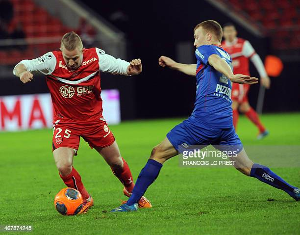 Valenciennes' French defender Rudy Mater vies for the ball with Nice's French midfielder Mathieu Bodmer during the French L1 football match between...