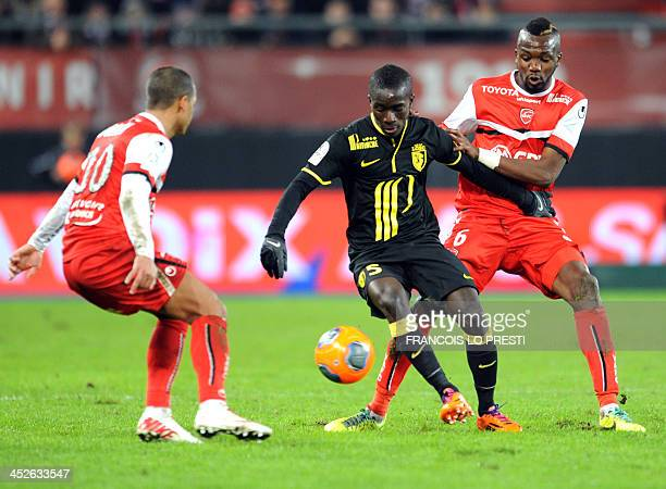Valenciennes' French forward JeanChristophe Bahebeck and Matthieu Dossevi challenge Lille's French defender Dijbril Sidibe during the French L1...