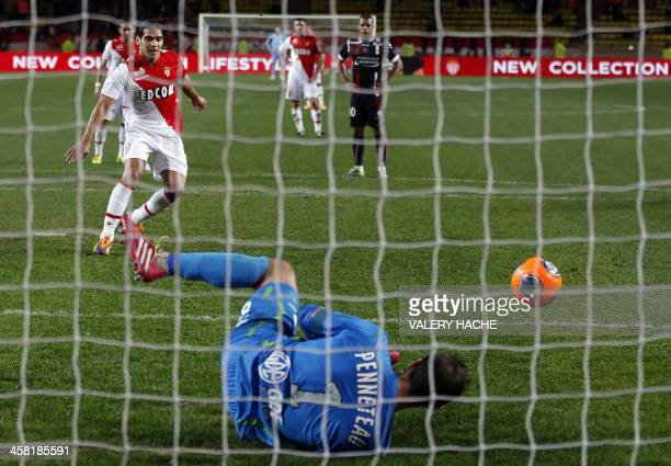Valenciennes' French goalkeeper Nicolas Penneteau saves a penalty kick by Monaco's Colombian forward Radamel Falcao during the French L1 football...