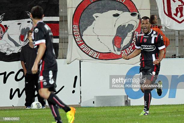 Valenciennes French midefielder Matthieu Dossevi celebrates after scoring a goal during the French L1 football match Ajaccio against Valenciennes on...