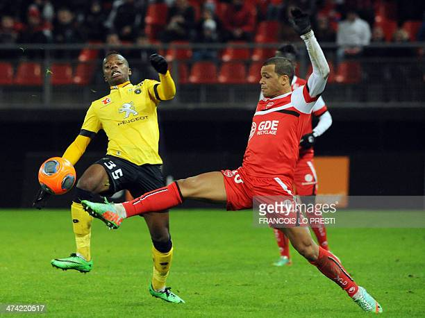 Valenciennes French midefielder Matthieu Dossevi vies for the ball with Sochaux' French defender Michel Malsa during the French L1 football match...