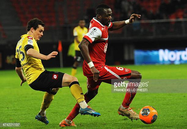 Valenciennes' FrenchMalian midfielder Tongo Doumbia vies for the ball with Sochaux's French midfielder Julien Faussurier during the French L1...