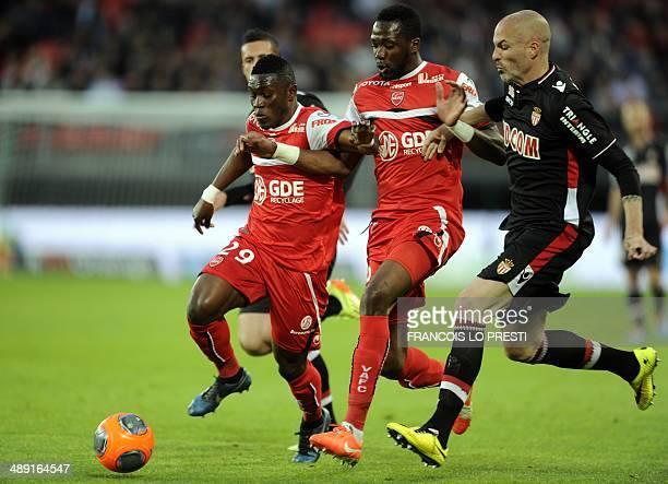 Valenciennes' Ghanaian forward Majeed Waris and Valenciennes' French and Malian midfielder Tongo Doumbia vie with Monaco's Italian defender Andrea...