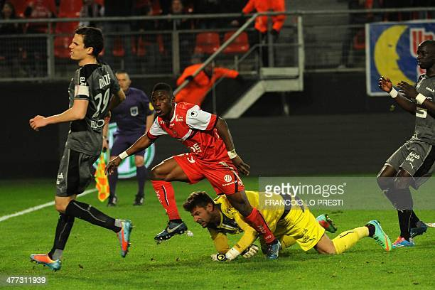 Valenciennes' Ghanean forward Majeed Waris reacts after scoring a goal during the French L1 football match Valenciennes vs Rennes at the stade Du...