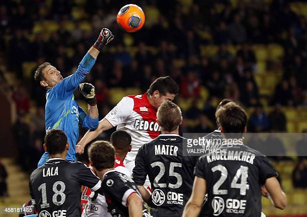 Valenciennes' goalkeeper Nicolas Penneteau blocks a shot on goal by Monaco's Colombian midfielder James Rodriguez during the French L1 football match...