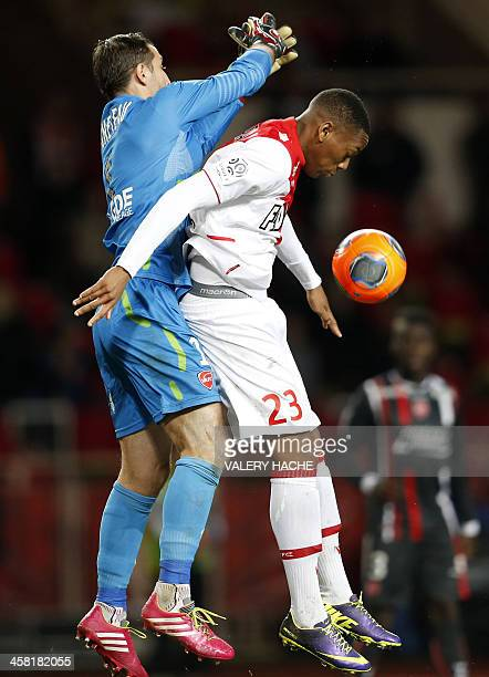 Valenciennes' goalkeeper Nicolas Penneteau challenges Monaco's French forward Anthony Martial during the French L1 football match between Monaco and...