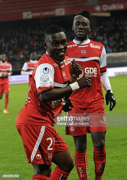 Valenciennes' Majeed Waris celebrates after scoring a goal during the French L1 football match Valenciennes vs Ajaccio at the Hainaut stadium in...