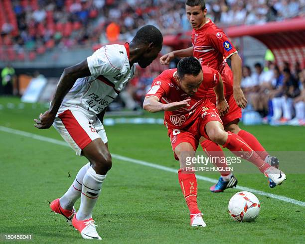 Valenciennes midfielder Gael Danic vies for the ball with Nice's Ivorian forward Franck Dja Djedje during the French L1 football match Valenciennes...