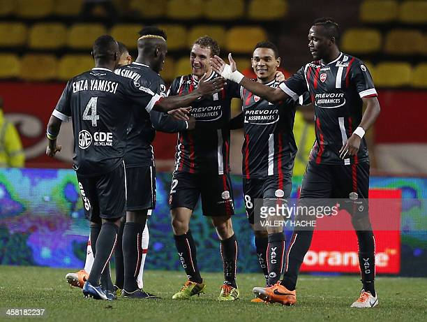 Valenciennes' players celebrate after scoring their second goal during the French L1 football match between Monaco and Valenciennes at the 'Louis II...