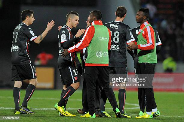 Valenciennes' players Loris Nery and Maor Melikson greet with teammates following the French L1 football match EvianThonon vs Valenciennes at the...