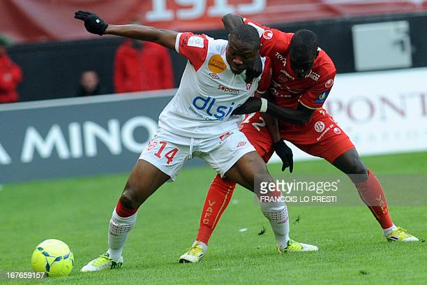Valenciennes' Senegalese midfielder Remi Gomis vies with Nancy's Cameroonian forward Paul Alo'o Efoulou during the French L1 football match...