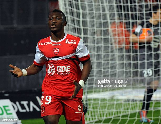 Valenciennes's Majeed Waris celebrates after scoring a goal during the French L1 football match Valenciennes vs Rennes at the Stade Du Hainaut in...