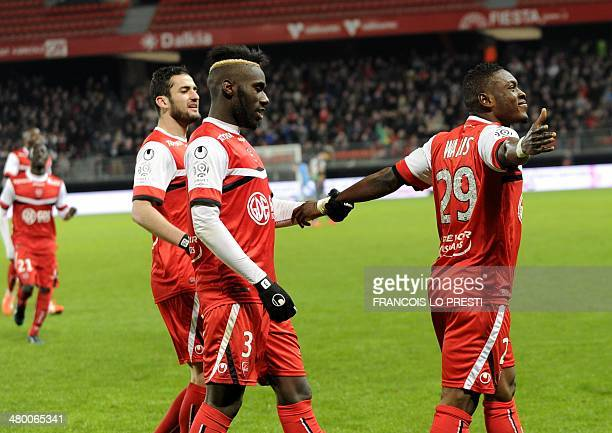 Valenciennes's Majeed Waris celebrates after scoring a goal during the French L1 football match Valenciennes vs Ajaccio at the Hainaut stadium in...