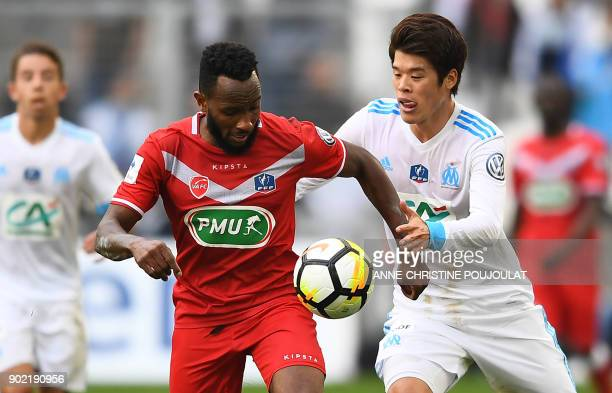 Valenciennes's midfielder Lenny Nangis vies with Japanese defender Hiroki Sakai during the French Cup football match between Olympique de Marseille...