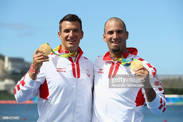 Valent Sinkovic and Martin Sinkovic of Croatia pose after winning the gold medal in the Men's Double Sculls Final A on Day 6 of the Rio 2016 Olympic...