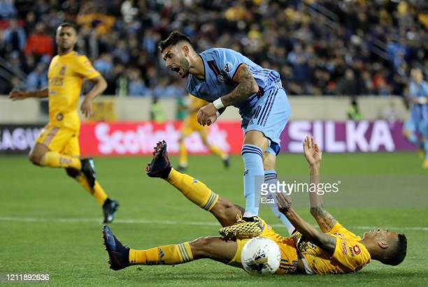 Valentin Castellanos of New York City FC and Francisco Meza of the UANL Tigres collide in the second half during Leg 1 of the quarterfinals during...