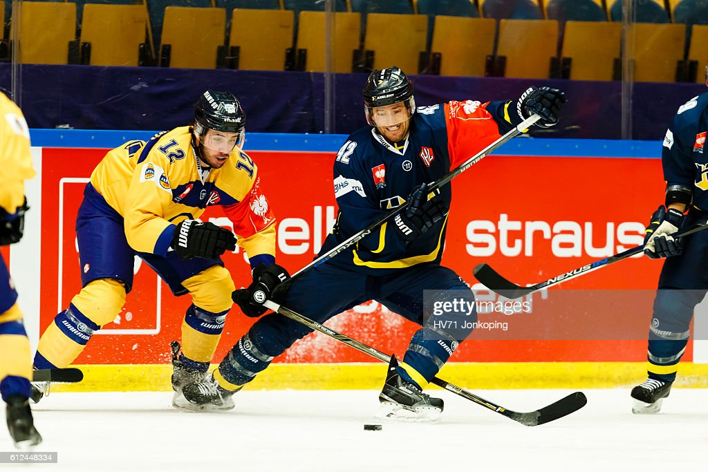 Valentin Claireaux #12 of Lukko Rauma challenges Dylan Reese #42 of HV71 Jonkoping, during the Champions Hockey League Round of 32 match between HV71 Jonkoping and Lukko Rauma at Kinnarps Arena on October 4, 2016 in Jonkoping, Sweden.