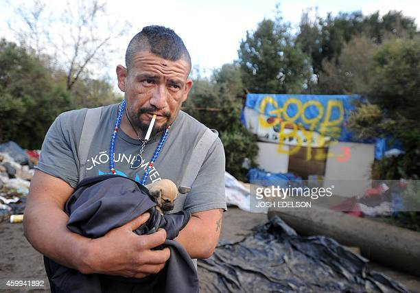Valentin Cortez a twoyear resident looks on as a Silicon Valley homeless encampment known as The Jungle is bulldozed on December 4 in San Jose...