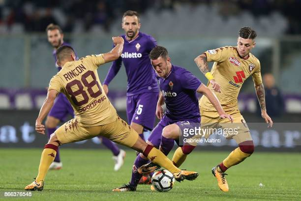Valentin Eysseric of ACF Fiorentina battles for the ball with Thomas Rincon of Torino Fc during the Serie A match between ACF Fiorentina and Torino...