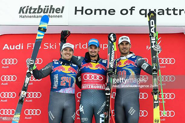 Valentin Giraud Moine of France takes 2nd place Dominik Paris of Italy takes 1st place Johan Clarey of France takes 3rd place during the Audi FIS...