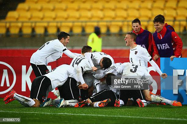 Valentin Grubeck of Austria celebrates his team's second goal with team mates during the FIFA U20 World Cup New Zealand 2015 Group B match between...