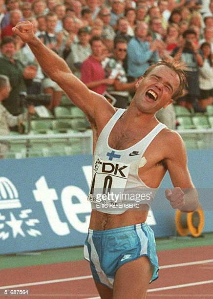 Valentin Kononen of Finland bursts out in jubilation as he crosses the finish line to win the 50 km walk final at the World Championships in...